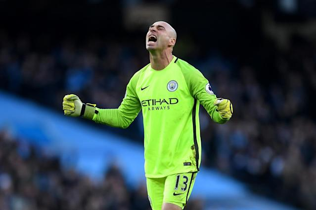 <p>Willy Caballero celebrates as the hosts level </p>