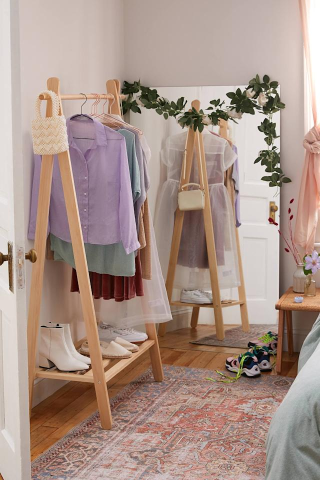 """<p>This <a href=""""https://www.popsugar.com/buy/Wooden-Clothing-Rack-487837?p_name=Wooden%20Clothing%20Rack&retailer=urbanoutfitters.com&pid=487837&price=129&evar1=casa%3Aus&evar9=46580615&evar98=https%3A%2F%2Fwww.popsugar.com%2Fhome%2Fphoto-gallery%2F46580615%2Fimage%2F46581129%2FWooden-Clothing-Rack&list1=shopping%2Corganization%2Cbedrooms%2Chome%20organization%2Chome%20shopping&prop13=api&pdata=1"""" rel=""""nofollow"""" data-shoppable-link=""""1"""" target=""""_blank"""" class=""""ga-track"""" data-ga-category=""""Related"""" data-ga-label=""""https://www.urbanoutfitters.com/shop/wooden-clothing-rack?category=dressers-wardrobes&amp;color=020&amp;type=REGULAR"""" data-ga-action=""""In-Line Links"""">Wooden Clothing Rack</a> ($129) is both practical and nice to look at.</p>"""
