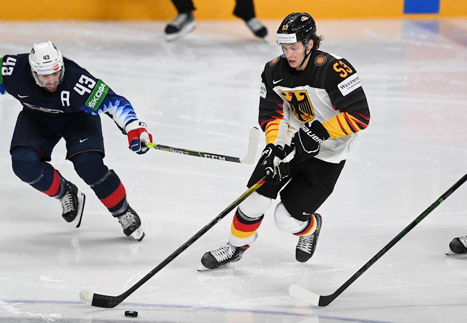 Germany's defender Moritz Seider (R) and US' forward Colin Blackwell vie for the puck during the IIHF Men's Ice Hockey World Championships preliminary round group B match between United States and Germany, at the Arena Riga in Riga, on May 31, 2021.