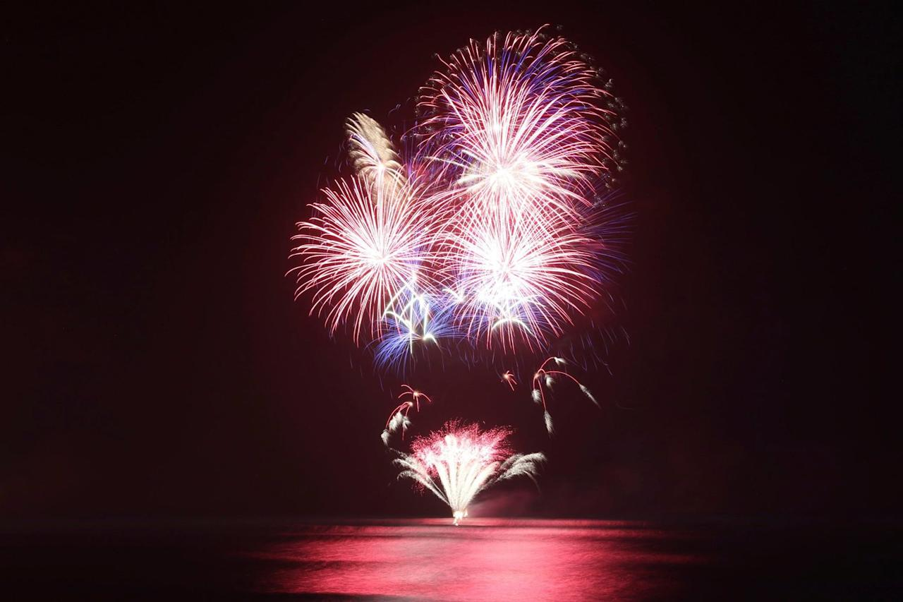 Fireworks go off over the Pacific Ocean at a New Year's Eve celebration in Kapolei, Hawaii.