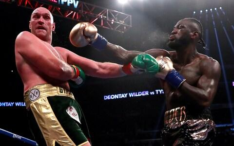 Tysn Fury and Deontay Wilder fought to a thrilling draw in December - Credit: Action Images