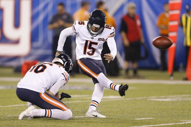 FILE - In this Aug. 16, 2019, file photo, Chicago Bears kicker Eddy Pineiro (15) kicks a field goal as punter Pat O'Donnell (16) holds during a preseason NFL football game against the New York Giants in East Rutherford, N.J. Pineiro emerged the winner in a kicking battle with Elliott Fry, and countless other candidates earlier. Pineiro has a strong leg, but has never kicked in a regular-season NFL game. (AP Photo/Adam Hunger, File)