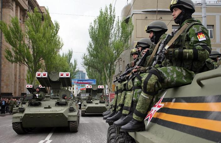 Pro-Russian separatists of the self-proclaimed Donetsk People's Republic sit atop a self-propelled gun during the Victory Day parade in Donetsk on May 9, 2015 (AFP Photo/Aleksey Filippov)