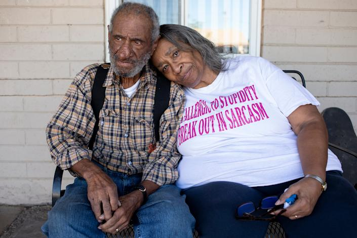 Gentry Gray, 84, and his wife, Victoria Gray, 69, sit for a portrait on Dec. 9, 2020, at their home in Phoenix.