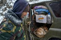 An Armenian leaving Lachin shows his 4x4 packed with belongings and a newborn calf