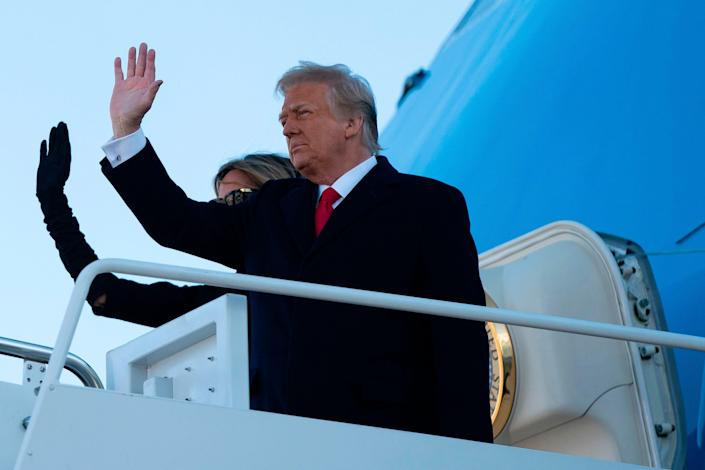 Former President Donald Trump and Former First Lady Melania Trump step into Air Force One at Joint Base Andrews in Maryland on Jan. 20, 2021.