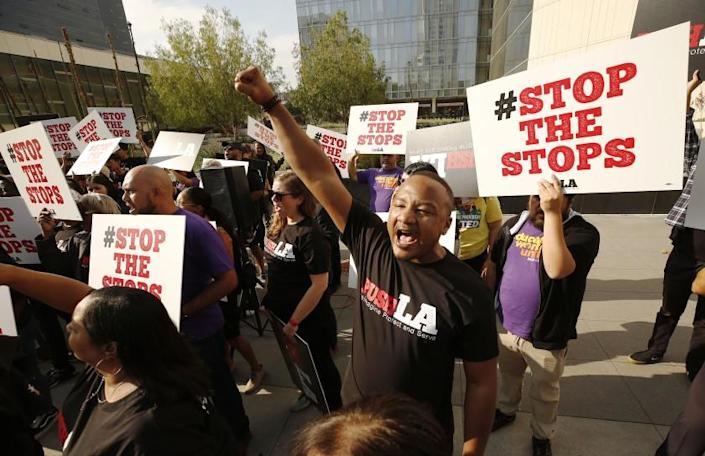 """LOS ANGELES, CA - OCTOBER 09, 2019 Kirk Samuels with Community Coalition chants with a group of nearly 100 people in a new coalition of 15 social justice organizations across Los Angeles called PUSH LA """"Reimagine Protect and Serve"""" massed for a press conference in front of LAPD Headquarters Wednesday morning with demands to Mayor Eric Garrett and LAPD Chief Michel Moore on police reform. The press conference was called after data featured in the LA Times revealed that LAPD is searching Black and Latinx drivers at rates of 4 to 1 and 3 to 1, respectively, compared to white drivers, but that they're finding less contraband. The group notes of there 350,000 stops analyzed over a 10 moth period, nearly three quarters of those stripped were Black and Latinx drivers and many of these searches happened after stops for minor equipment violations. The group claims these disparities are clear evidence of racial profiling that is happening across all divisions of the LAPD. (Al Seib / Los Angeles Times)"""
