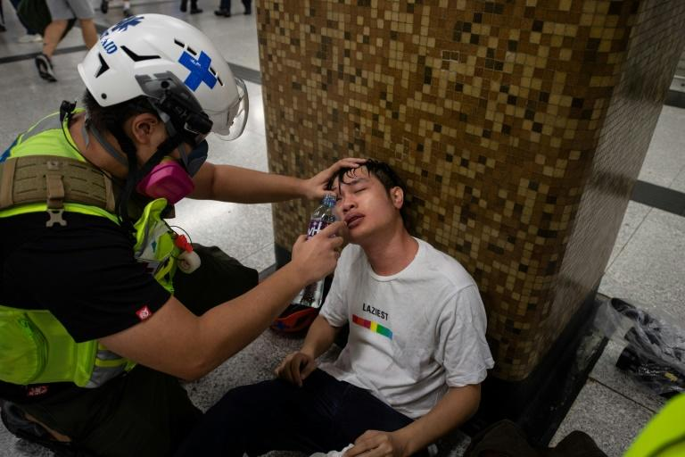 The role of volunteer medics has grown more important as protests have become increasingly violent (AFP Photo/ANTHONY WALLACE)