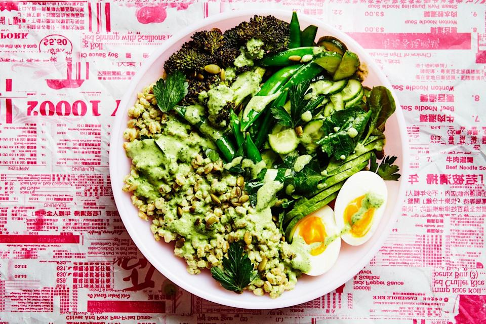 """Bright and refreshing green goddess dressing perks up the grains in this delicious bowl. It's filled to the brim with alllllll the green veggies and creamy sliced avocado. <a href=""""https://www.epicurious.com/recipes/food/views/green-goddess-buddha-bowl?mbid=synd_yahoo_rss"""" rel=""""nofollow noopener"""" target=""""_blank"""" data-ylk=""""slk:See recipe."""" class=""""link rapid-noclick-resp"""">See recipe.</a>"""