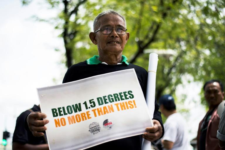 Environmental activists have protested outside Bangkok's UN building to call for more accountability on climate change