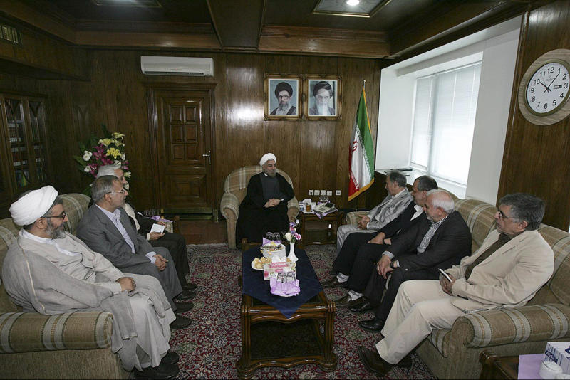 In this Sunday, June 23, 2013 photo released by the official website of the office of Iranian President-elect Hasan Rouhani, Rouhani, center, attends a meeting with a group of pro-reform political figures, at his office, in Tehran, Iran. The Iranian president's inner circle brings more than new names to the Islamic Republic's power structures _ the group of advisers and allies also carries an array of degrees from Western universities. Few doubt that Hasan Rouhani will bring a far calmer and more measured approach than his predecessor. What remains unclear is how much it could actually influence Iranian policies. (AP Photo/Office of the President-elect, Mohammad Berno)