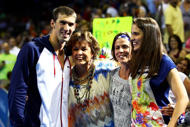 OMAHA, NE - JUNE 30:  Michael Phelps poses for a photo with his mom Debbie and sisters Hilary and Whitney afterthe medal ceremony for the Men's 200 m Individual Medley during Day Six of the 2012 U.S. Olympic Swimming Team Trials at CenturyLink Center on June 30, 2012 in Omaha, Nebraska.  (Photo by Al Bello/Getty Images)