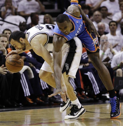 Oklahoma City Thunder power forward Serge Ibaka, right, from the Republic of Congo, fouls San Antonio Spurs shooting guard Manu Ginobili (20), of Argentina, during the first half of Game 5 in the NBA basketball Western Conference finals, Monday, June 4, 2012, in San Antonio. (AP Photo/Eric Gay)
