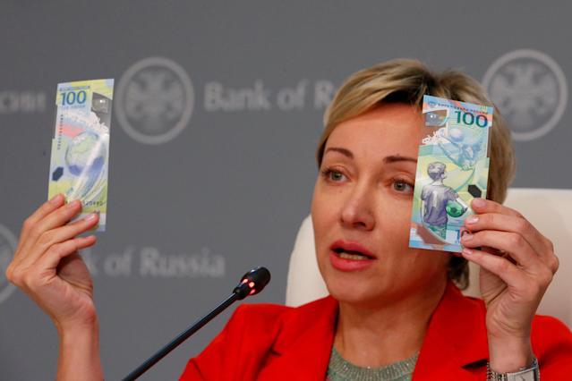 Russian central bank deputy chairwoman Olga Skorobogatova holds the newly designed 100-rouble banknotes dedicated to the 2018 FIFA World Cup, during a news conference in Moscow, Russia May 22, 2018. REUTERS/Sergei Karpukhin TPX IMAGES OF THE DAY
