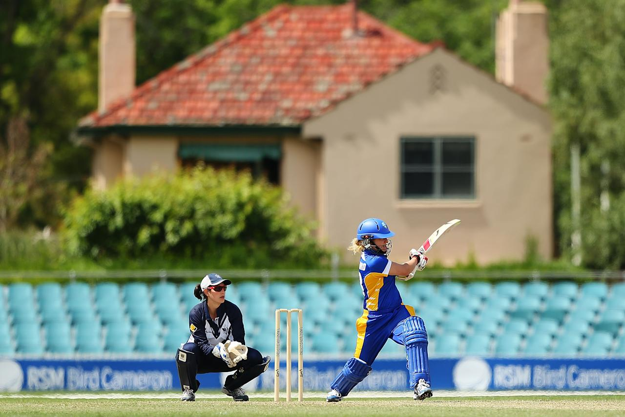 CANBERRA, AUSTRALIA - NOVEMBER 10:  Sara Hungerford of the Meteors bats during the WNCL match between the ACT Meteors and the Victoria Spirit at Manuka Oval on November 10, 2012 in Canberra, Australia.  (Photo by Brendon Thorne/Getty Images)