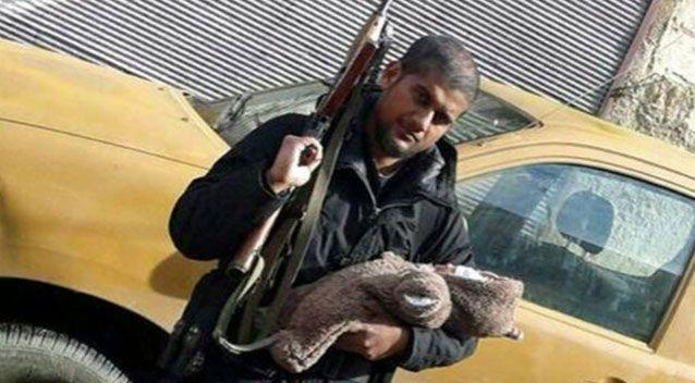 'Jihadi Sid' Abu Rumaysah in the Middle East with his infant son.