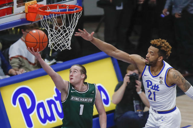 Binghamton's Hakon Hjalmarsson (1) shoots as Pittsburgh's Terrell Brown (21) defends during the second half of an NCAA college basketball game Friday, Dec. 20, 2019, in Pittsburgh. Pittsburgh won 79-53. (AP Photo/Keith Srakocic)