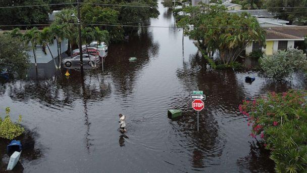 PHOTO: HALLANDALE, FLORIDA - DECEMBER 23: An aerial view from a drone shows a woman crossing a street inundated with flood water on December 23, 2019 in Hallandale, Florida. (Joe Raedle/Getty Images)
