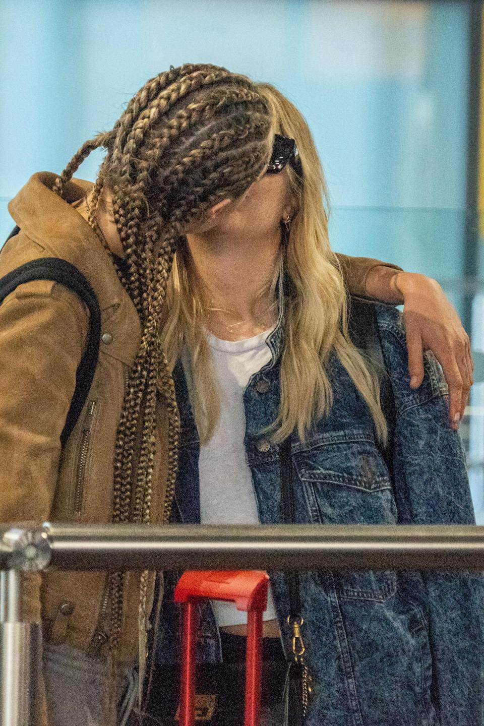 Cara Delevingne and Ashley Benson took their relationship public, kissing outside London's Heathrow Airport. (Photo: SplashNews)