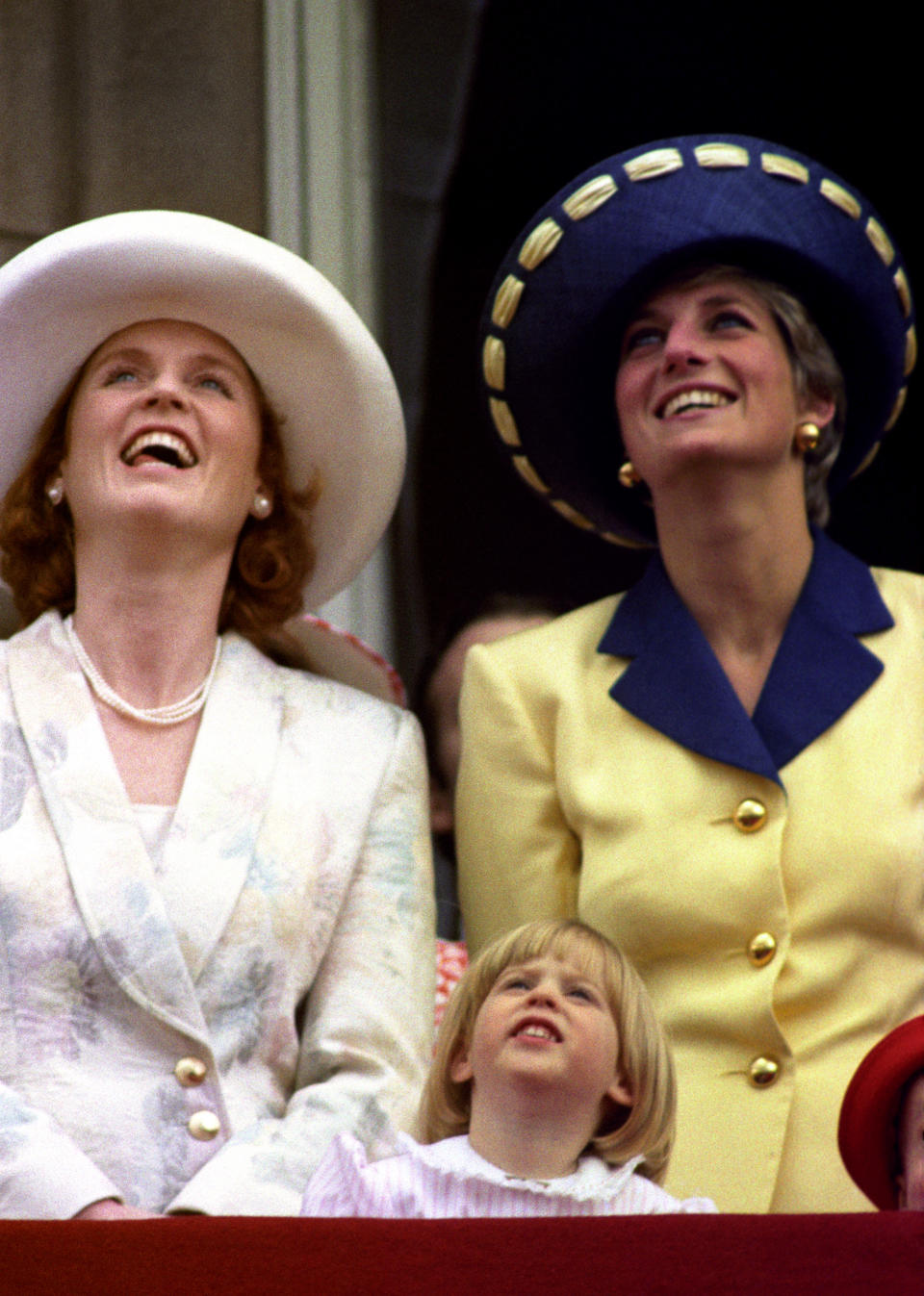 Sarah Ferguson, Duchess of York with daughter Princess Beatrice and Princess Diana look up at the fly-past. (PA Images)