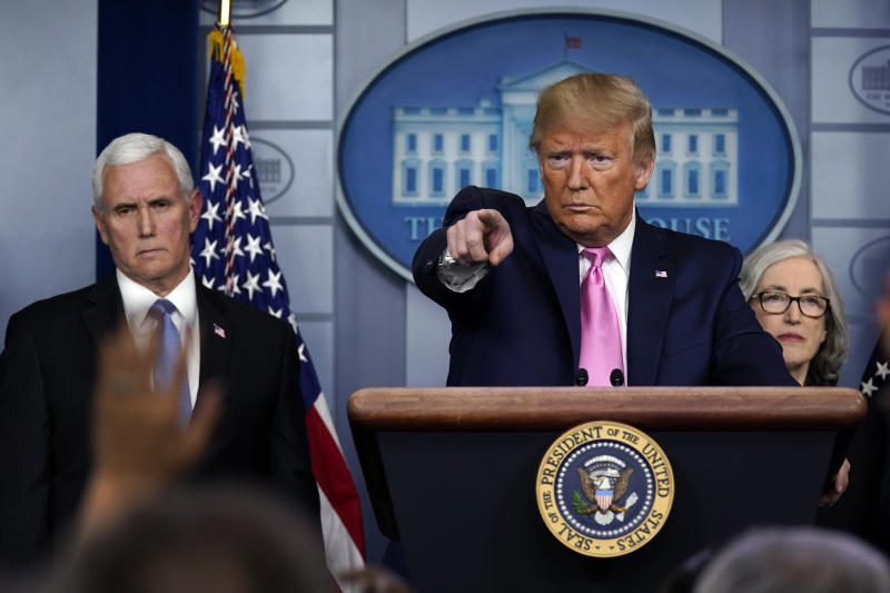 President Donald Trump, with members of the president's coronavirus task force, speaks during a news conference in the Brady Press Briefing Room of the White House, Wednesday, Feb. 26, 2020, in Washington. At left is Vice President Mike Pence. (AP Photo/Evan Vucci)