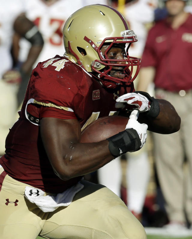 In this Sept. 28, 2013 photo, Boston College's Andre Williams runs during the first half of an NCAA college football game against Florida State in Boston. Williams is a Heisman Trophy finalist. (AP Photo/Stephan Savoia)