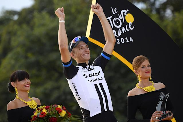 Stage winner Marcel Kittel celebrates on the podium in Paris after winning the last stage of the Tour de France on July 27, 2014 (AFP Photo/Lionel Bonaventure)