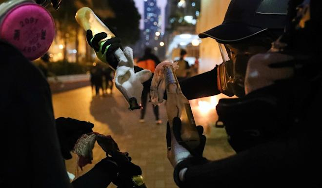 Protesters prepare petrol bombs in the Sham Shui Po district of Hong Kong on October 1. Photo: AFP