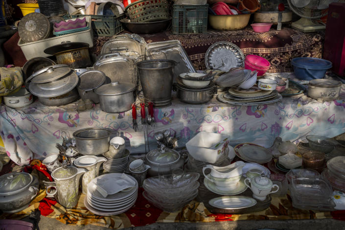 Household items are displayed at a flea market in Kabul, Afghanistan, Monday, Sept. 27, 2021. Second-hand markets have proliferated in Kabul where many families have sold their belongings before leaving the country or due to financial struggle. (AP Photo/Bernat Armangue)