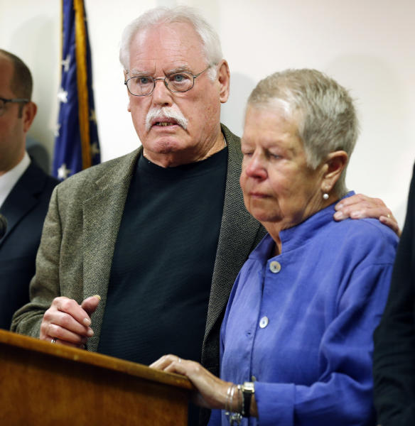 John Lyon hugs his wife, Mary, right, after a plea by Lloyd Lee Welch Jr., for the killings of their daughters Sheila and Katherine Lyon in 1975, in Bedford County Circuit Court in Bedford, Va., Tuesday, Sept. 12, 2017. Welch plead guilty to two first degree murder charges and was sentenced to two consecutive 48 year terms. (AP Photo/Steve Helber)