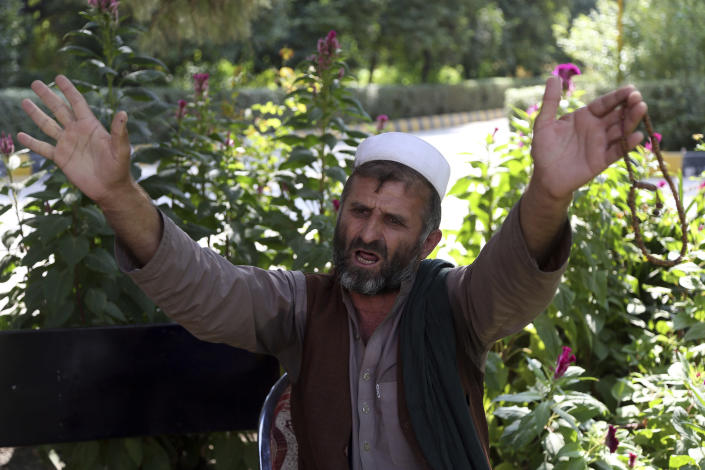 """In this Tuesday, Oct. 1, 2019, photo, Mohammad Hasan, who lost seven members of his family, speaks during an interview to the Associated Press in Jalalabad city east of Kabul, Afghanistan, Eighteen years into this war and America would seem to be losing the battle for the """"hearts and minds,"""" of Afghans as anger mounts over the numbers of civilians killed by U.S. and Afghan. (AP Photo/Rahmat Gul)"""