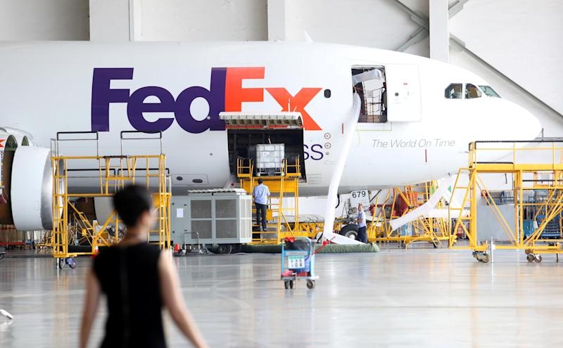 A FedEx Express plane is seen at a maintenance base of Guangzhou Aircraft Maintenance Engineering Company Limited (GAMECO) at the airport in Guangzhou, Guangdong province, China August 16, 2018. Picture taken August 16, 2018. Feng Zhoufeng/Southern Metropolis Daily via REUTERS ATTENTION EDITORS - THIS IMAGE WAS PROVIDED BY A THIRD PARTY. CHINA OUT.