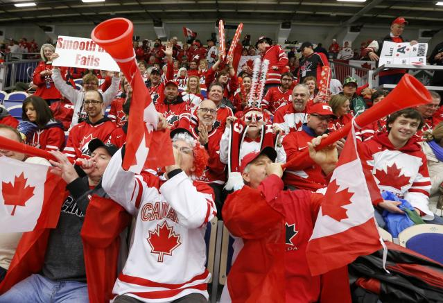 Canadian fans cheer while watching Canada and the Czech Republic during the first period of their IIHF World Junior Championship ice hockey game in Malmo, Sweden, December 28, 2013. REUTERS/Alexander Demianchuk (SWEDEN - Tags: SPORT ICE HOCKEY)