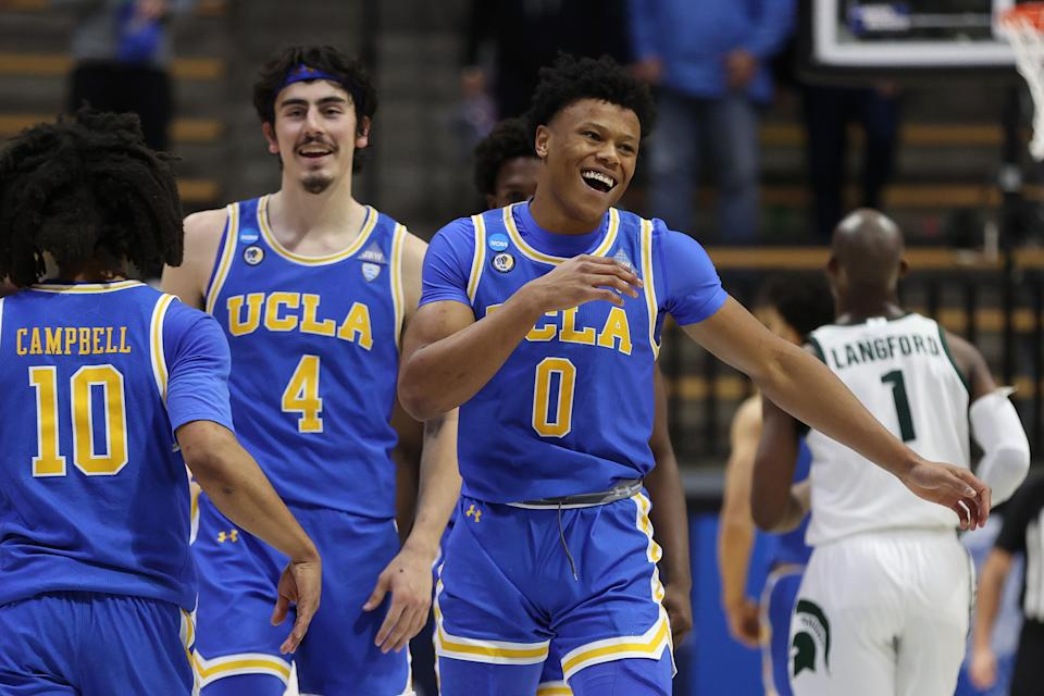 WEST LAFAYETTE, INDIANA - MARCH 18: Jaylen Clark #0 of the UCLA Bruins celebrates with teammates after defeating the Michigan State Spartans in the First Four game prior to the NCAA Men's Basketball Tournament at Mackey Arena on March 18, 2021 in West Lafayette, Indiana. (Photo by Gregory Shamus/Getty Images)