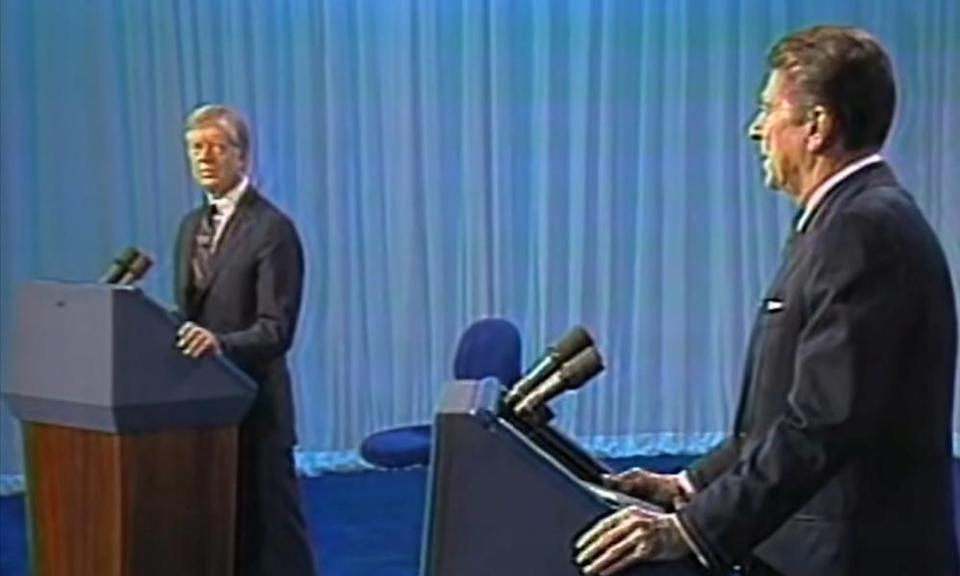 Jimmy Carter and Ronald Reagan during a debate in 1980.