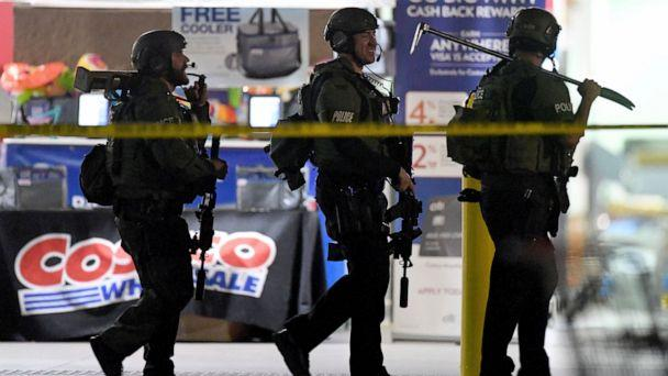 Heavily armed police officers exit the Costco following a shooting inside the wholesale warehouse in Corona, Calif., Friday, June 14, 2019. A gunman opened fire inside the store during an argument, killing a man, wounding two other people and sparkin (The Associated Press)