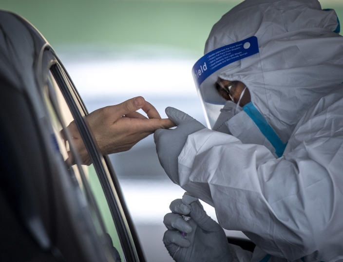 A health care worker prepares to administer a drive through antibody test at Belmont Medical Care in Franklin Square, N.Y. (Getty Images)