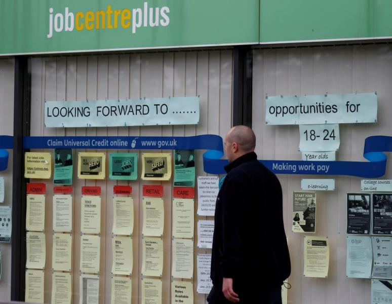 FILE PHOTO: A man walks past a job centre following the outbreak of the coronavirus disease (COVID-19), in Manchester