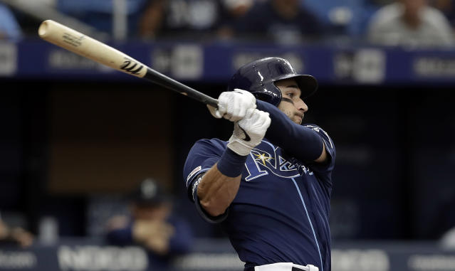 Tampa Bay Rays' Kevin Kiermaier lines a two-run single off Seattle Mariners' Wade LeBlanc during the fourth inning of a baseball game Wednesday, Aug. 21, 2019, in St. Petersburg, Fla. (AP Photo/Chris O'Meara)