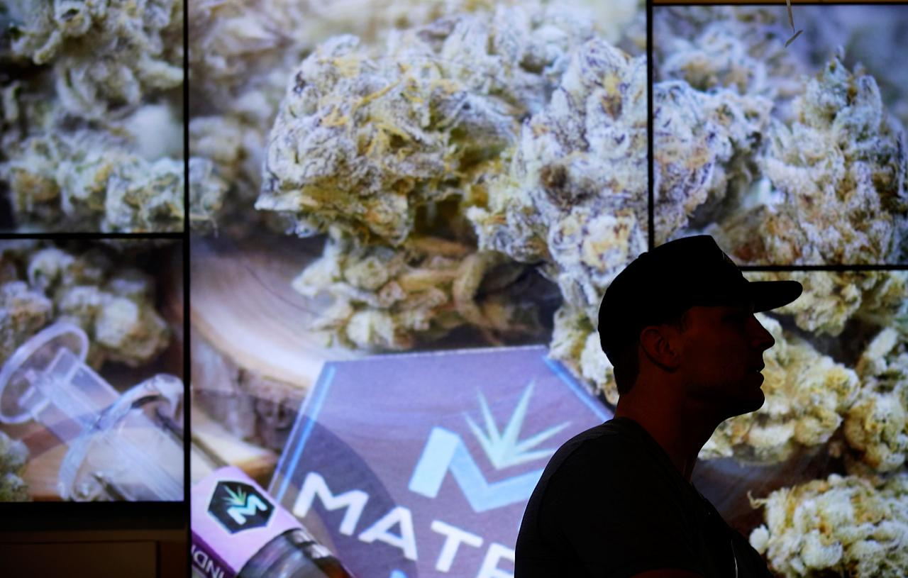 <p>A man waits in line at The Source dispensary, Saturday, July 1, 2017, in Las Vegas. (Photo: John Locher/AP) </p>