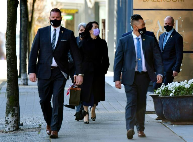 Huawei Chief Financial Officer Meng Wanzhou, arrives at court in British Columbia, Canada, with her security team as she contests here arrest on a US extradition warrant