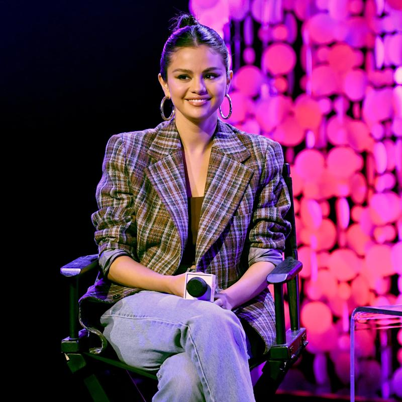 BURBANK, CALIFORNIA - JANUARY 09: Selena Gomez speaks on stage at the iHeartRadio Album Release Party with Selena Gomez at iHeartRadio Theater on January 09, 2020 in Burbank, California. (Photo by Kevin Winter/Getty Images for iHeart)