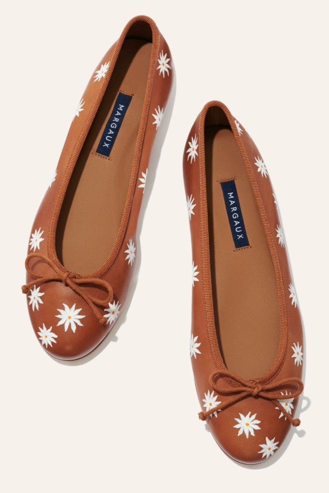 """<p><span>Custom Margaux Demi Flat</span> ($148 with customization starting at $80)</p> <p>""""Margaux is known for its ultrastylish, <em>ultracomfortable</em> flats, but the customization makes them even more covetable. You can choose between hand-painted monogramming or this sweet daisy design, making this a very special gift for someone who has an eye for great details and a preference for very chic footwear."""" - HWM </p>"""