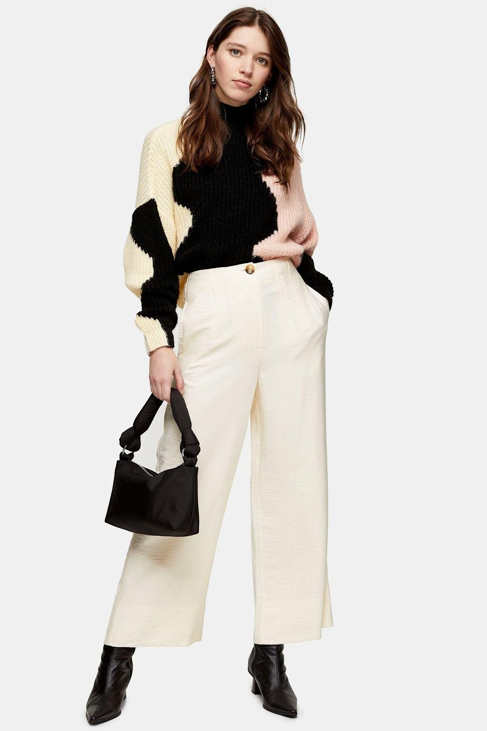 """<p><strong>Topshop</strong></p><p>topshop.com</p><p><strong>$55.00</strong></p><p><a href=""""https://go.redirectingat.com?id=74968X1596630&url=https%3A%2F%2Fus.topshop.com%2Fen%2Ftsus%2Fproduct%2Fecru-stitch-wide-leg-pants-9837733&sref=https%3A%2F%2Fwww.cosmopolitan.com%2Fstyle-beauty%2Ffashion%2Fg10327302%2Fcute-fall-outfits%2F"""" rel=""""nofollow noopener"""" target=""""_blank"""" data-ylk=""""slk:Shop Now"""" class=""""link rapid-noclick-resp"""">Shop Now</a></p><p>Wide-leg pants will never not be in, so I think you def need these! The cream hue will actually go with so much more than you think, like this fun color-block sweater.</p>"""