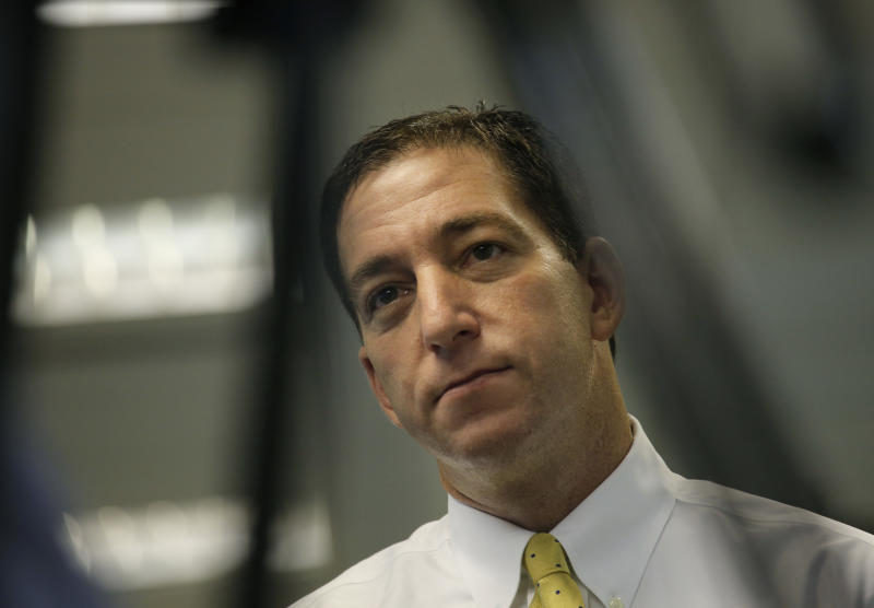 Glenn Greenwald, a reporter of Britain's The Guardian newspaper, speaks to The Associated Press in Hong Kong Tuesday, June 11, 2013. Greenwald, the journalist who interviewed Edward Snowden, a 29-year-old contractor who allowed himself to be revealed as the source of disclosures about the U.S. government's secret surveillance programs, said he had been in touch with Snowden, but declined to say whether he was still in Hong Kong and said he didn't know what his future plans were. (AP Photo/Vincent Yu)