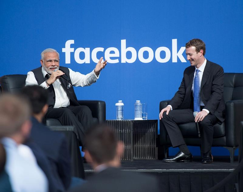 Indian Prime Minister Narendra Modi and Facebook CEO Mark Zuckerberg (right) attend a Townhall meeting, at Facebook headquarters in Menlo Park, California, on September 27, 2015