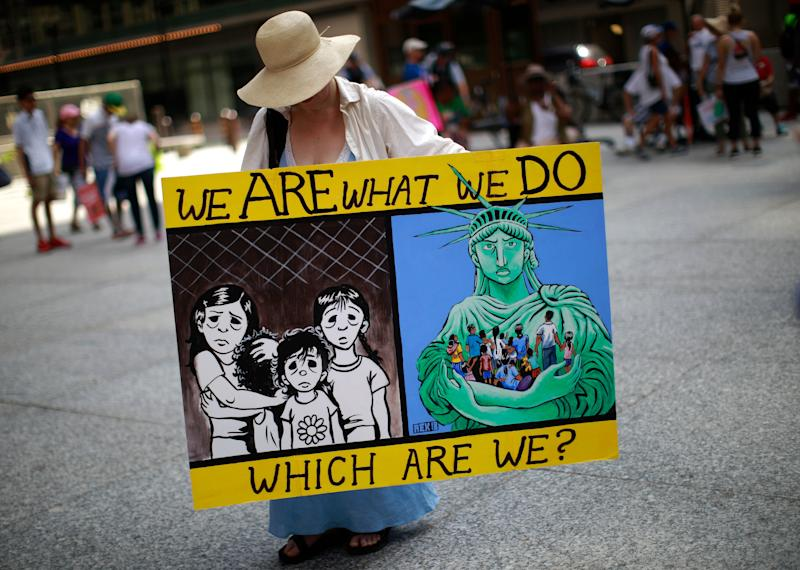 A woman takes part in a protest against the US immigration policies separating migrant families in Chicago, June 30, 2018. - Demonstrations are being held across the US on Saturday, June 30, 2018 against President Donald Trump's hardline immigration policy. (Photo by JIM YOUNG / AFP) (Photo credit should read JIM YOUNG/AFP/Getty Images)