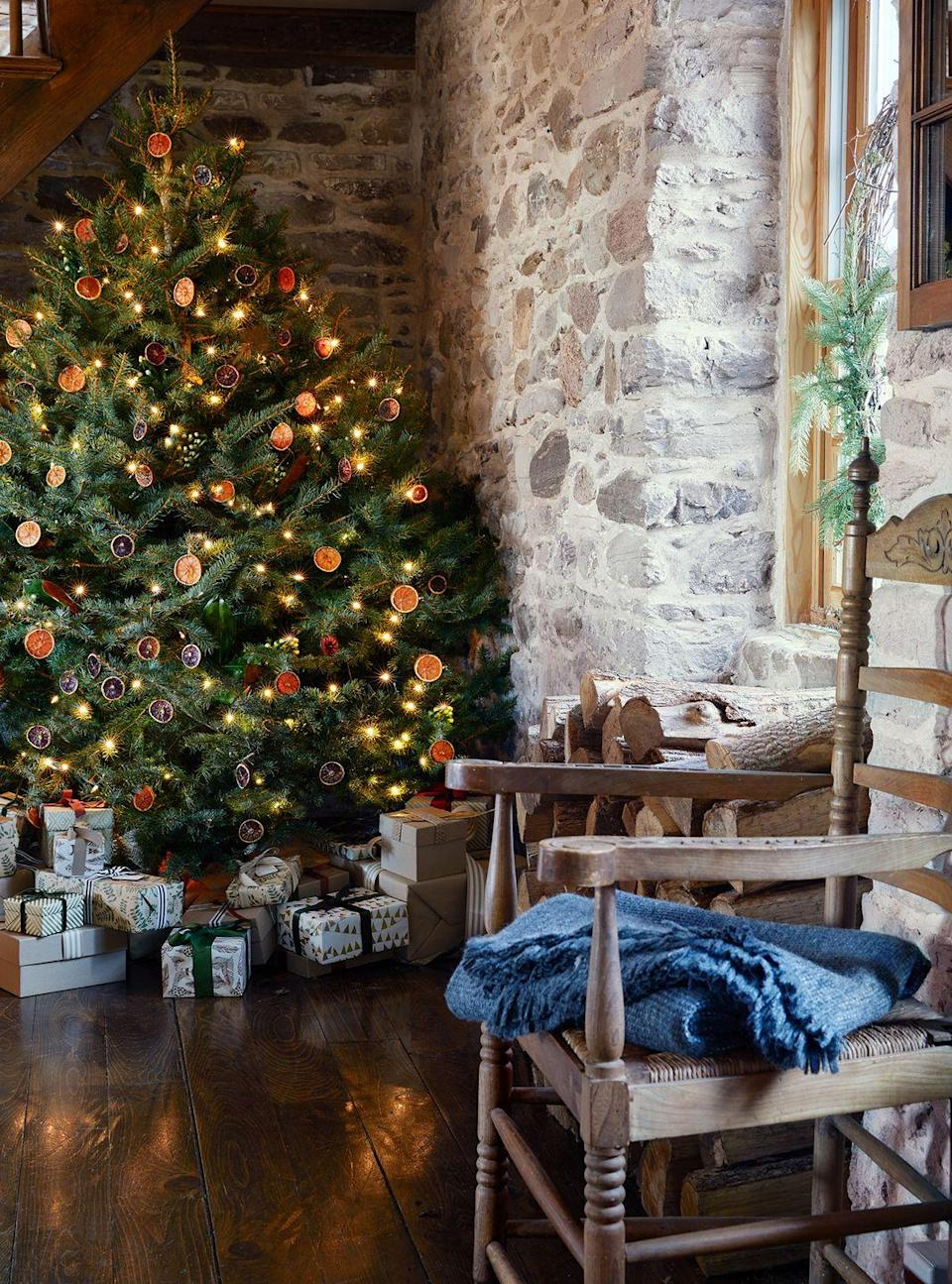 """<p>Equal parts unexpected and refreshing, spruce up your tree with dried orange slices if you're seeking a conversation starter for your celebration. </p><p><strong>RELATED:</strong> <a href=""""https://www.goodhousekeeping.com/holidays/christmas-ideas/a24803/tips-to-keep-a-christmas-tree-fresh/"""" rel=""""nofollow noopener"""" target=""""_blank"""" data-ylk=""""slk:How to Make Your Christmas Tree Last Longer"""" class=""""link rapid-noclick-resp"""">How to Make Your Christmas Tree Last Longer</a></p>"""