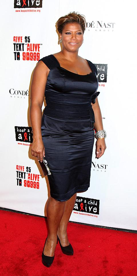 "Queen Latifah, who was honored for her humanitarian work, added a touch of bling to her classy black cocktail dress. Janet Mayer/<a href=""http://www.splashnewsonline.com/"" target=""new"">Splash News</a> - November 13, 2008"
