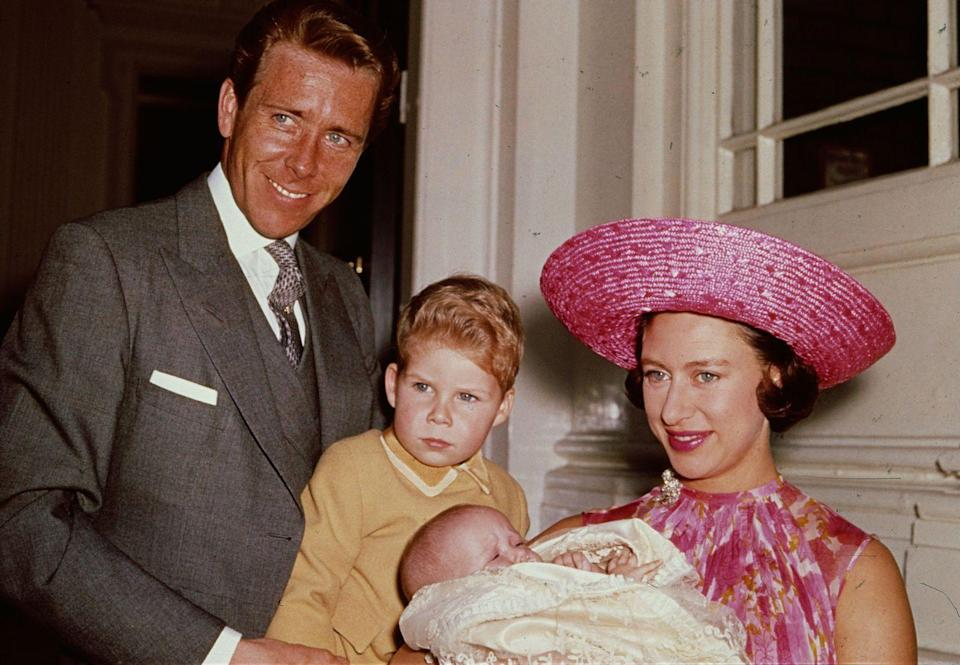 """<p>Princess Margaret chose a pink woven hat and patterned dress to show off her new daughter, Lady Sarah Armstrong-Jones, with her then-husband <a href=""""https://www.townandcountrymag.com/society/news/a9255/princess-margaret-lord-snowdon-relationship/"""" rel=""""nofollow noopener"""" target=""""_blank"""" data-ylk=""""slk:Lord Snowdon"""" class=""""link rapid-noclick-resp"""">Lord Snowdon</a> and their son Viscount Linley. </p>"""